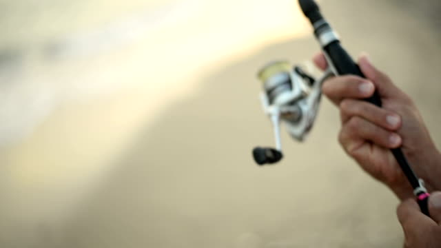 man fishing. - fishing rod stock videos & royalty-free footage
