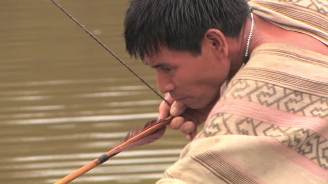 cu man fishing with bow and arrow/ manu national park, peru - minority groups stock videos & royalty-free footage