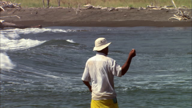 ms man fishing with handline in nosara river mouth / guanacaste, costa rica - nosara stock videos and b-roll footage