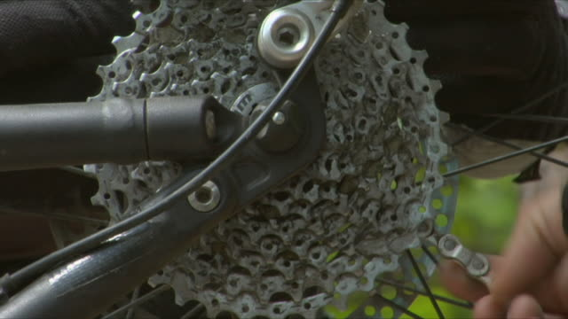 cu man fixing bike chain / kent, england, uk - see other clips from this shoot 1036 stock videos and b-roll footage
