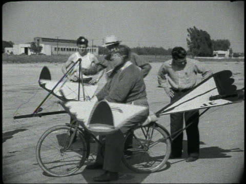 b/w man flapping wings of bicycle with wings + tail - air vehicle stock videos & royalty-free footage