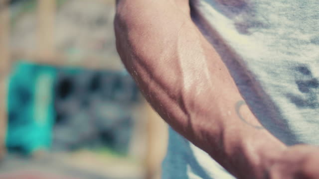 man flexing his arm muscle - flexing muscles stock videos & royalty-free footage