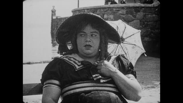 1917 man flirts with man (fatty arbuckle), who is disguised as woman - fatty arbuckle stock videos and b-roll footage