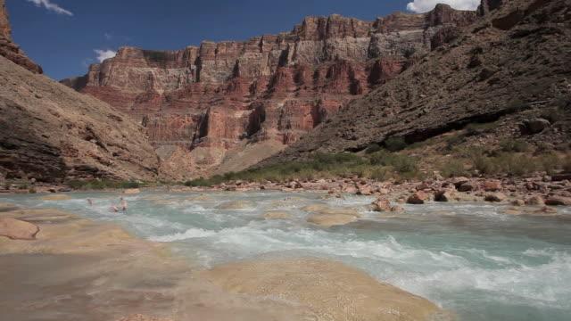 WS Man floating down rapids of river Colorado in Grand Canyon / Grand Canyon Village, Arizona, USA