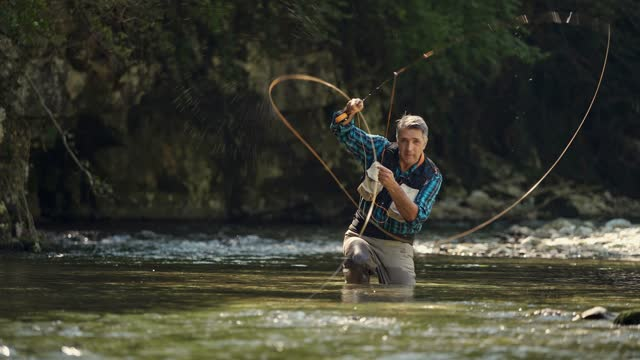 man fly fishing in river - vermont stock videos & royalty-free footage