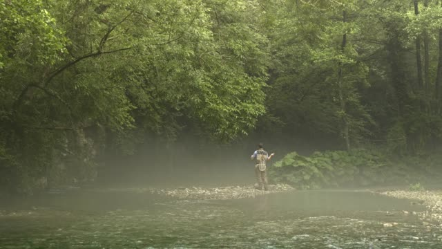 man fly fishing in vermont - vermont stock-videos und b-roll-filmmaterial