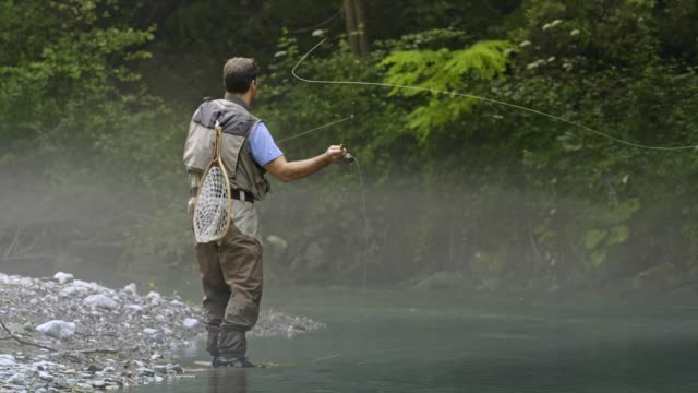 man fly fishing in vermont - new england usa stock videos & royalty-free footage