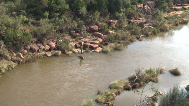 Man fly fishing on a river in South Africa