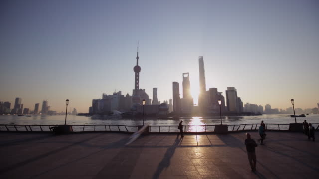 ws man flying a bird kite on the bund in the morning, shanghai, china - the bund stock videos & royalty-free footage