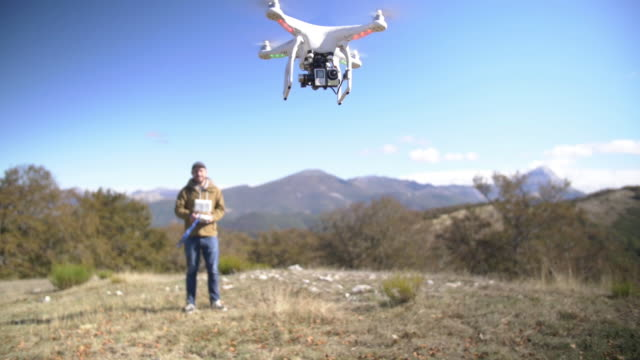 man flying a drone - drone pilot stock videos and b-roll footage
