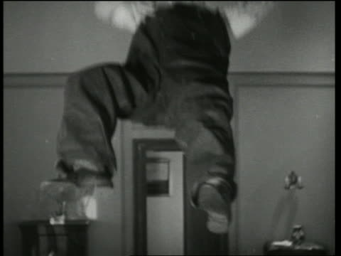 b/w 1935 man flying up into air in room / why pay rent? - 1935 stock videos & royalty-free footage