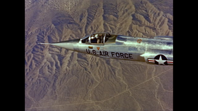WS AERIAL POV Man flying US Air Force airplane with landscape in background / United States