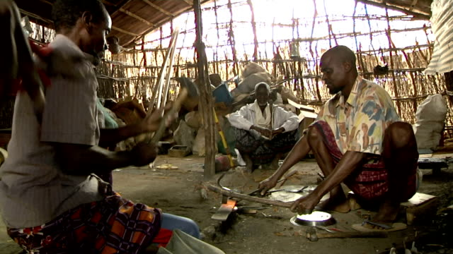 man forging piece of metal on august 01, 2011 in dadaab village, kenya - horn of africa stock videos & royalty-free footage