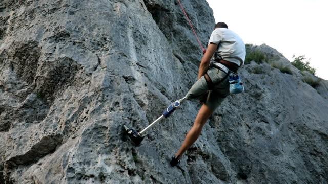 man free climbing - adaptive athlete stock videos and b-roll footage