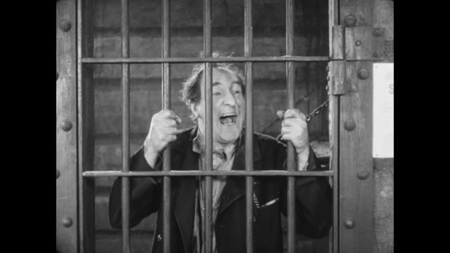 1928 a man (buster keaton) frees his former employer (ernest torrence) from prison after a fight with the sheriff - prison escape stock videos and b-roll footage