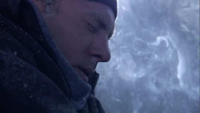 a man freezes in a vehicle during a blizzard. - hypothermia stock videos and b-roll footage