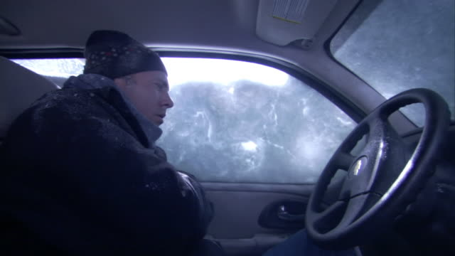 A man freezes in an SUV during a blizzard.