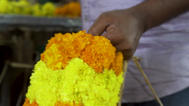 cu man from india working at floral garlands market - chennai stock videos & royalty-free footage