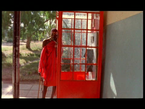 ds ,cu, man from samburu tribe talking on pay phone in british style telephone booth, rift valley, kenya - 1995 stock videos & royalty-free footage