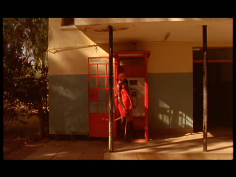 td, ms, man from samburu tribe talking on pay phone in british style telephone booth, rift valley, kenya - telephone booth stock videos & royalty-free footage