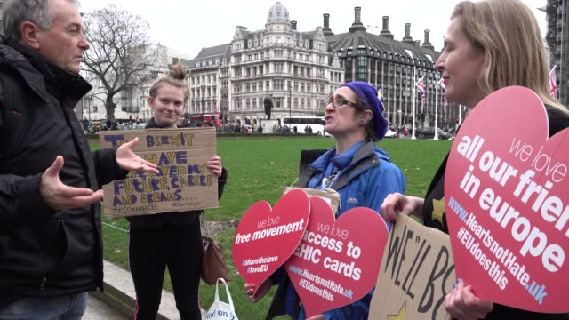 man from switzerland argues with anti-brexit protestors on parliament square on the morning of the day the uk leaves the european union - fighting stock videos & royalty-free footage