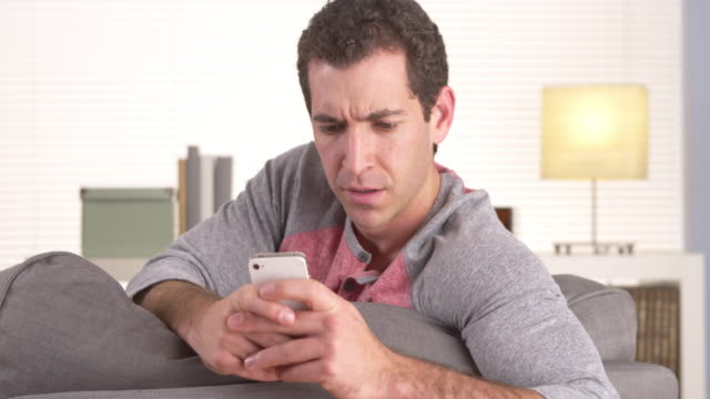 Man frustrated with smartphone