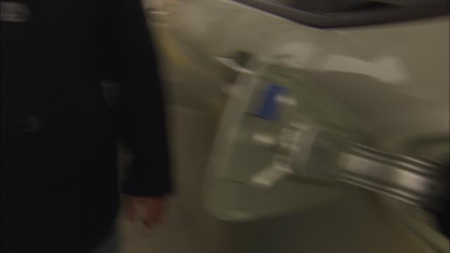 a man fuels a car with hydrogen. - hydrogen stock videos & royalty-free footage