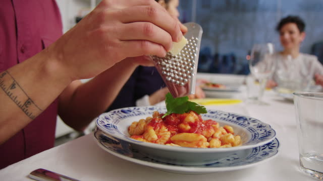 man garnishing pasta with cheese at cooking class - garnish stock videos & royalty-free footage