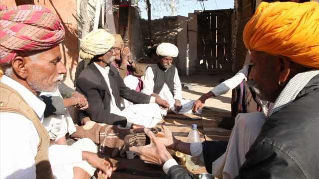 ms man gathered for opium ceremony / rajasthan, india - ceremony stock videos and b-roll footage