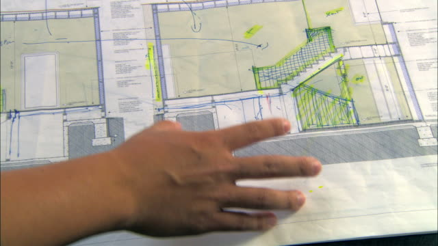 CU, TU, PAN, Man gesturing over architectural blueprint, close-up of hand