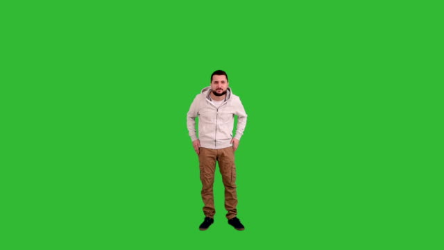 man gesturing surprised and perplexed sign on green screen background - full length stock videos & royalty-free footage