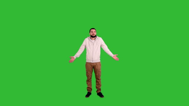 man gesturing surprised and perplexed sign on green screen background - male animal stock videos & royalty-free footage