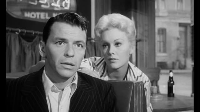 1955 man (frank sinatra) gets an audition after woman (kim novak) suggests he call the manager - frank sinatra stock videos & royalty-free footage