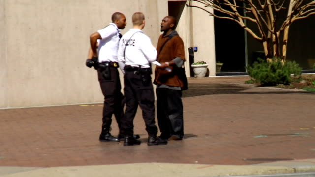 man gets arrested after arguing with police on march 13, 2012 in washington, dc - arrest stock videos & royalty-free footage