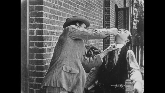 1919 man (buster keaton) gets beat up after refusing bribe - 1910 1919 stock videos & royalty-free footage