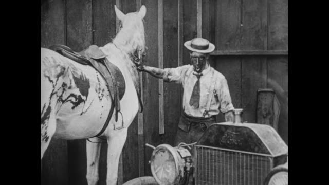 1922 man (buster keaton) gets motor oil over beautiful white horse - motor oil stock videos & royalty-free footage