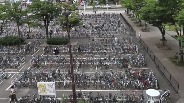 a man gets on a taxi at a taxi stand in niigata niigata prefecture japan on wednesday aug 2016 taxis queue near a taxi stand in niigata niigata... - bicycle parking station stock videos and b-roll footage