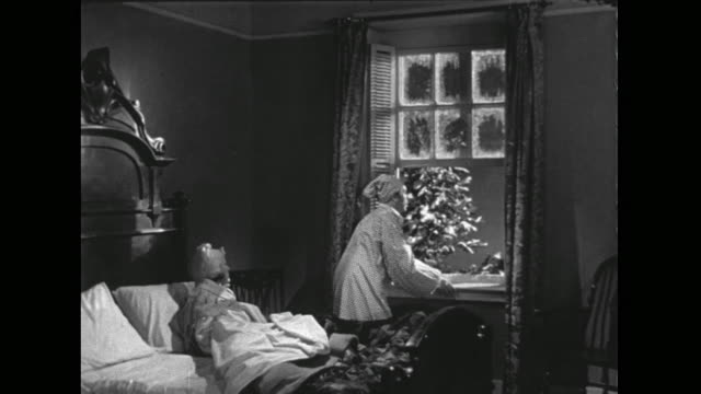 1946 Man gets out of bed and hurries to window to hear sleigh bells and laughing