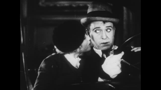 vidéos et rushes de 1933 man (harry langdon) gets the girl and tries to drive model car out of wax museum - museum