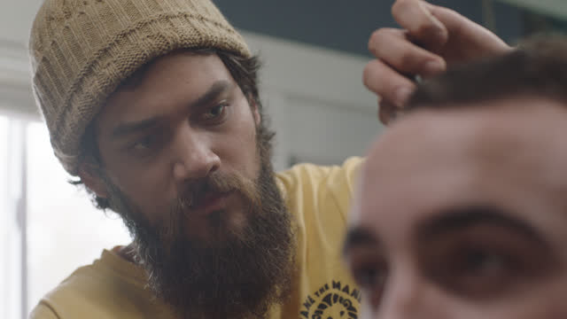 cu. a man gets the sides of his hair trimmed - sideburn stock videos & royalty-free footage