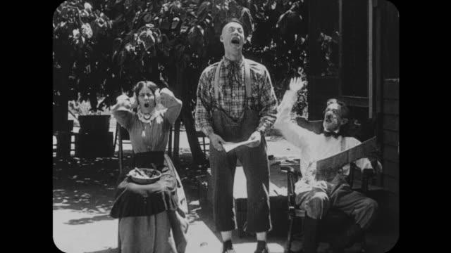 1916 man gets upset after showing letter to parents and ends up head first in haystack - skälla ut bildbanksvideor och videomaterial från bakom kulisserna