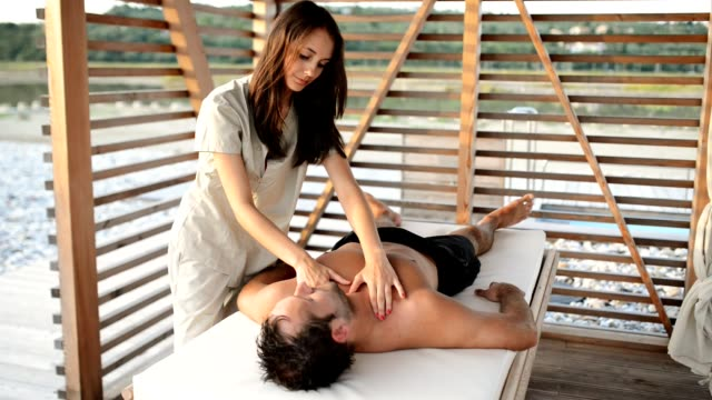 man getting a body massage - massage table stock videos and b-roll footage