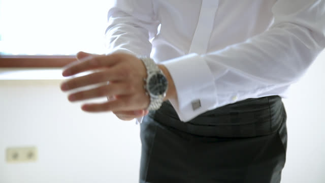 man getting dressed, putting wrist watch on his hand - all shirts stock videos & royalty-free footage