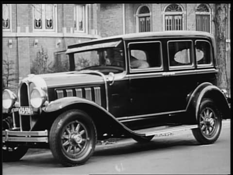 b/w 1928 man getting out of oakland car in front of house (2 shots) / industrial - 1928 stock videos & royalty-free footage