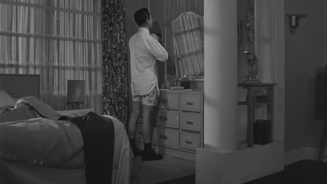 man getting ready with shirt and tie but no pants gets shocked to see a picture on the newspaper and runs out the door without his pants on. - shirt and tie 個影片檔及 b 捲影像