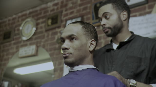 ms la man getting up from barber's chair, brooklyn, new york city, new york state, usa - see other clips from this shoot 1437 stock videos and b-roll footage