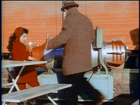 1958 man + girl walking away from boy sitting on coin-operated ride outdoors / newsreel - coin operated stock videos & royalty-free footage