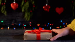 4K A man gives a lady a gift box on Valentine's Day.