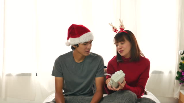 Man giving a Christmas present to his girlfriend