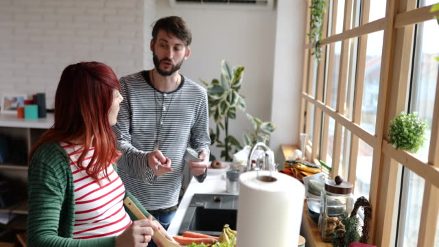 man giving advice to his pregnant wife how to make better salad - candid stock videos & royalty-free footage